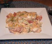 Eiersalat mit Mais und Tomate