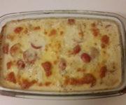 Mozzarella auf Hähnchen in Basilikum